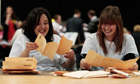Election officials laugh as they count Scottish parliamentary election voting papers in Aberdeen
