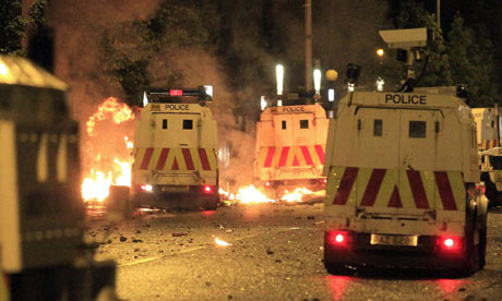 Loyalist rioters use fire bombs on police officers in east Belfast, Northern Ireland, last Wednesday