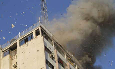 Smoke rises after an Israeli air strike on an office of Hamas television channel al-Aqsa