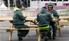 Private security guards aat their lunch near the Olympics stadium in east London