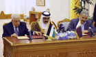 Mahmoud Abbas, left, and Khaled Mashal, right, sit with the emir of Qata