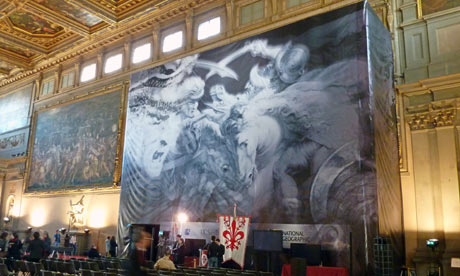 Banner showing the painting which might be hidden behind the wall in Florence's Palazzo Vecchio