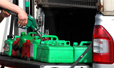 A person fills up petrol tanks at a petrol station in Linlithgow