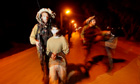 Israeli soldiers lead arrested Palestinian youths
