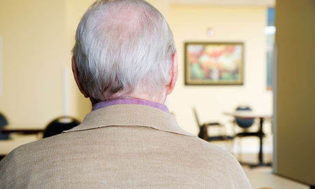 An elderly man sitting in a chair