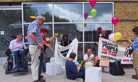 Campaigners protest outside Scope's offices in north London last month