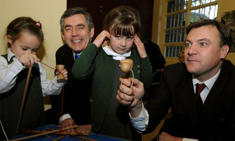 Gordon Brown and the children's minister, Ed Balls, with children at Bethnal Green Museum of Childhood ahead of the publication of the government's children's plan
