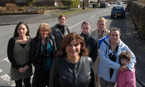 Lorrine Marer (centre) has been advising mothers from Trafford's Sale Moor estate who signed up for tips on parenting
