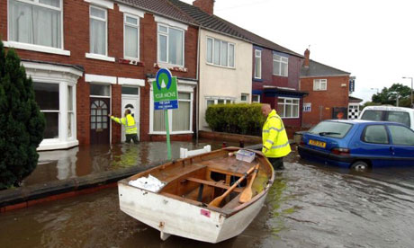 Doncaster council workers delivery food by boat during last year's floods