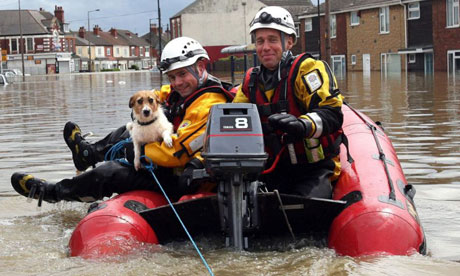 Firefighters save a dog as flood waters rise in Toll Bar near Doncaster, South Yorkshire