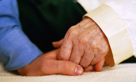 Older person holds hands