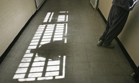 A prison inmate looks out of the window