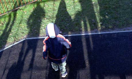 Sad child alone outside nursery