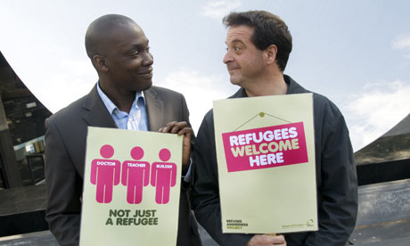 Comedian Mark Thomas with Genius, a refugee from Zimbabwe