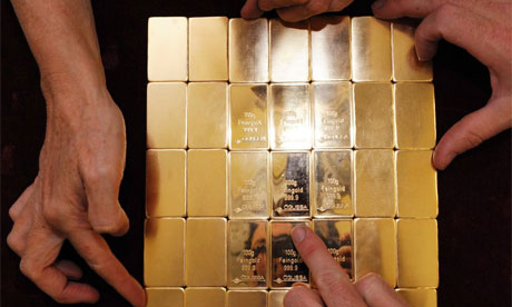 Austian workers hold gold during stamping