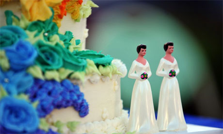 A wedding cake with statuettes of two women is seen during the demonstration in West Hollywood, California