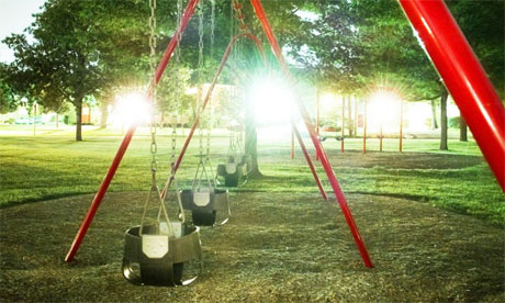 Swings on playground, night