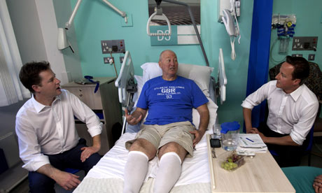 David Cameron and Nick Clegg with NHS patient