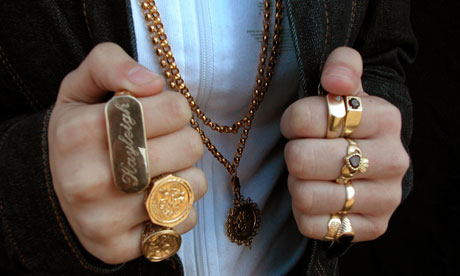 Teenage girl wearing gold sovereign rings and gold chains
