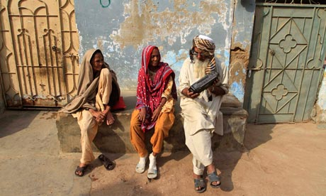 People listen to the radio in Karachi, Pakistan