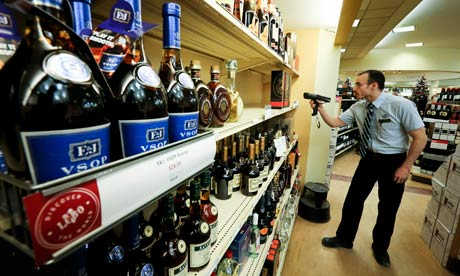 An LCBO employee checks the stock at the Queens Quay liquor store in Toronto.
