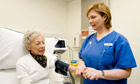 Elderly Patient receiving care from a Nurse. Image shot 2007. Exact date unknown.
