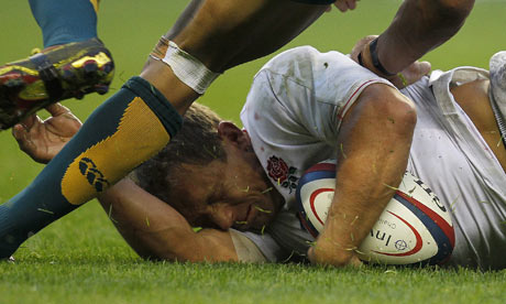 Jonny Wilkinson falls to the ground after being tackled