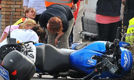 A motorbike crashed into fans lining the route of the classic Paris-Roubaix cycling race.