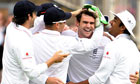 Jimmy Anderson is mobbed after taking the wicket of Mitchell Johnson