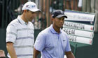 Tiger Woods and Padraig Harrington are at the top of the leaderboard after the opening round
