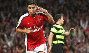 Eduardo celebrates after scoring his controversial penalty against Celtic