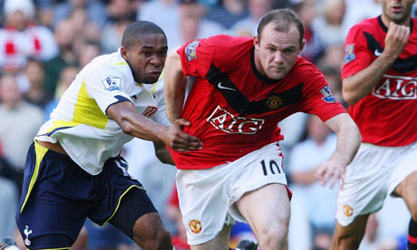 Wayne Rooney tussles for the ball