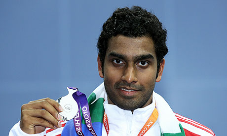 Rajiv Ouseph with the silver medal he won in the men's badminton final at the Commonwealth Games