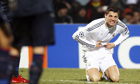 Cristiano Ronaldo reacts after missing a chance for Real Madrid against Lyon