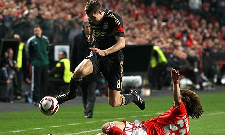 Steven Gerrard, left, skips over a tackle from David Luiz