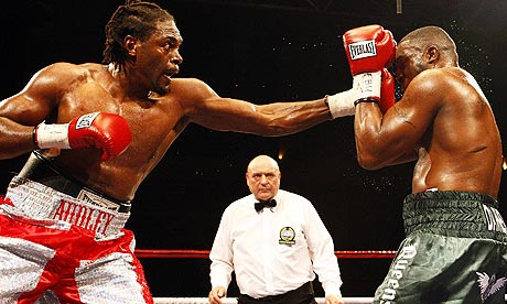 Audley Harrison, left, lands a punch on Michael Sprott during their European heavyweight title fight