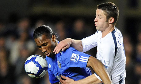 Didier Drogba, left, fights for the ball with Bolton defender Gary Cahill