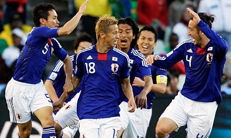Japan's Keisuke Honda, centre, celebrates