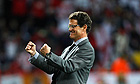 Fabio Capello celebrates England's win over Slovenia in Port Elizabeth