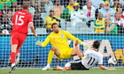 Miroslav Klose slots the ball past David James to open the scoring