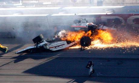 Drivers Dan Wheldon, front, and Will Power crash at the Las Vegas Motor Speedway