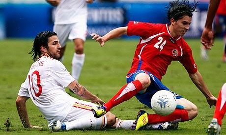 Spain's Cesc Fabregas challenges Costa Rica's Jose Bryan Oviedo in San Jose