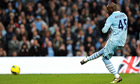 Manchester City's Italian striker Mario Balotelli scores his penalty against Newcastle United