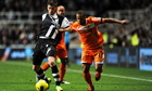 Newcastle United's Davide Santon and Swansea City's Wayne Routledge, right, in action.