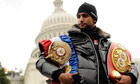 Amir Khan poses with his belts in front of the Capitol Building