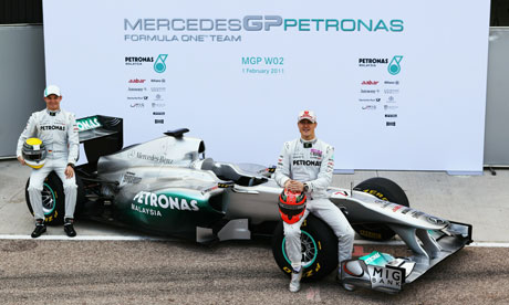 Nico Rosberg and Michael Schumacher unveil the new Mercedes W02
