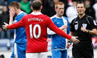 Wayne Rooney protests his innocence
