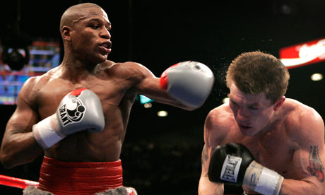Mayweather Jr. lands a punch on Hatton during their WBC welterweight title fight in Las Vegas