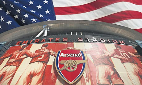 The Emirates Stadium backed by American flag