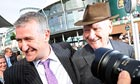 Donald McCain the trainer of the Grand National winner Ballabriggs, embraces his father, Ginger